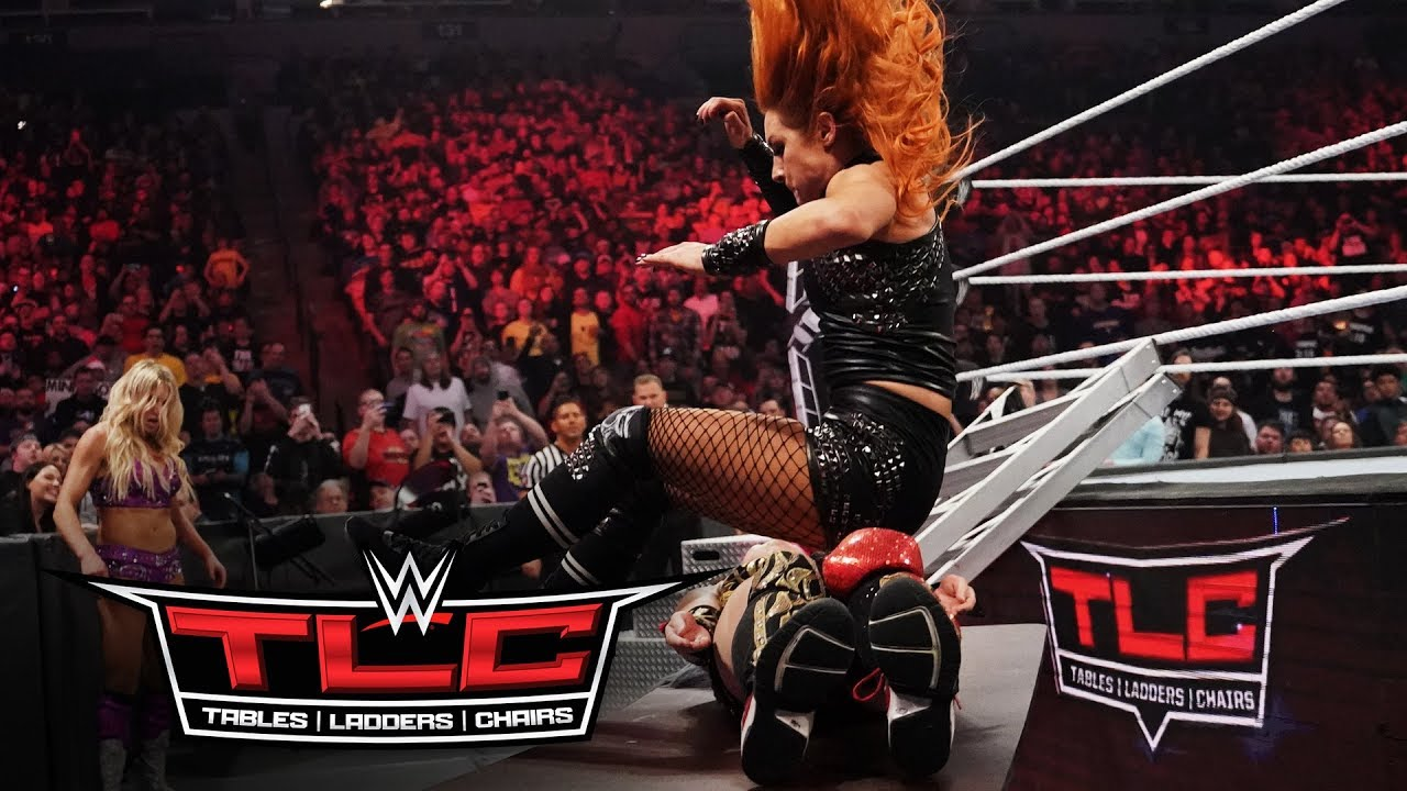 Becky Lynch sends Asuka through a table with a flying leap – WWE TLC 2019