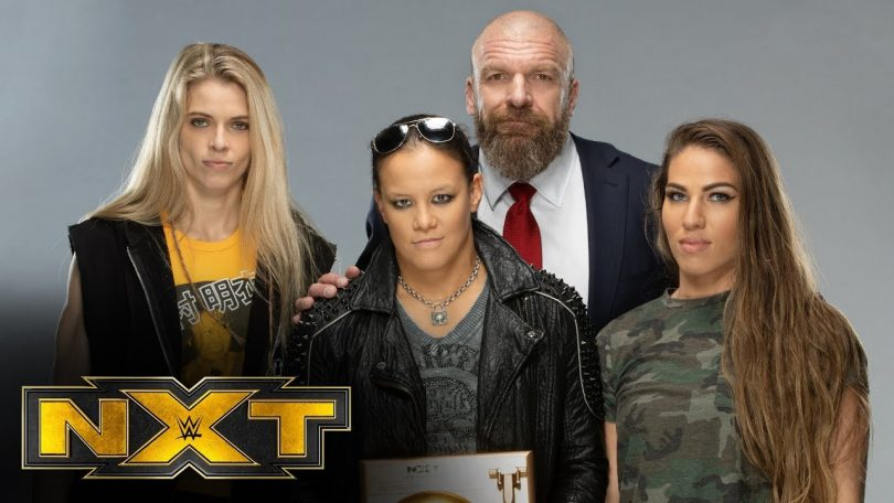 triple h poses with the nxt year